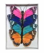 Feest 4x gekleurde vlinders op draad 9 cm decoratie