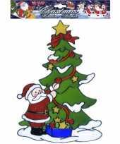 Feest kerst raamsticker kerstman bij kerstboom