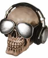 Feest schedel spaarpot met koptelefoon